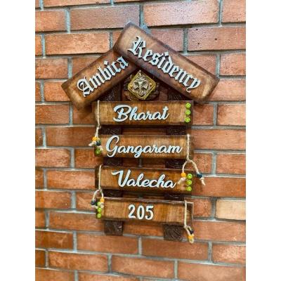 Lord Ganesh Wooden Hut Family Nameplate  family nameplate